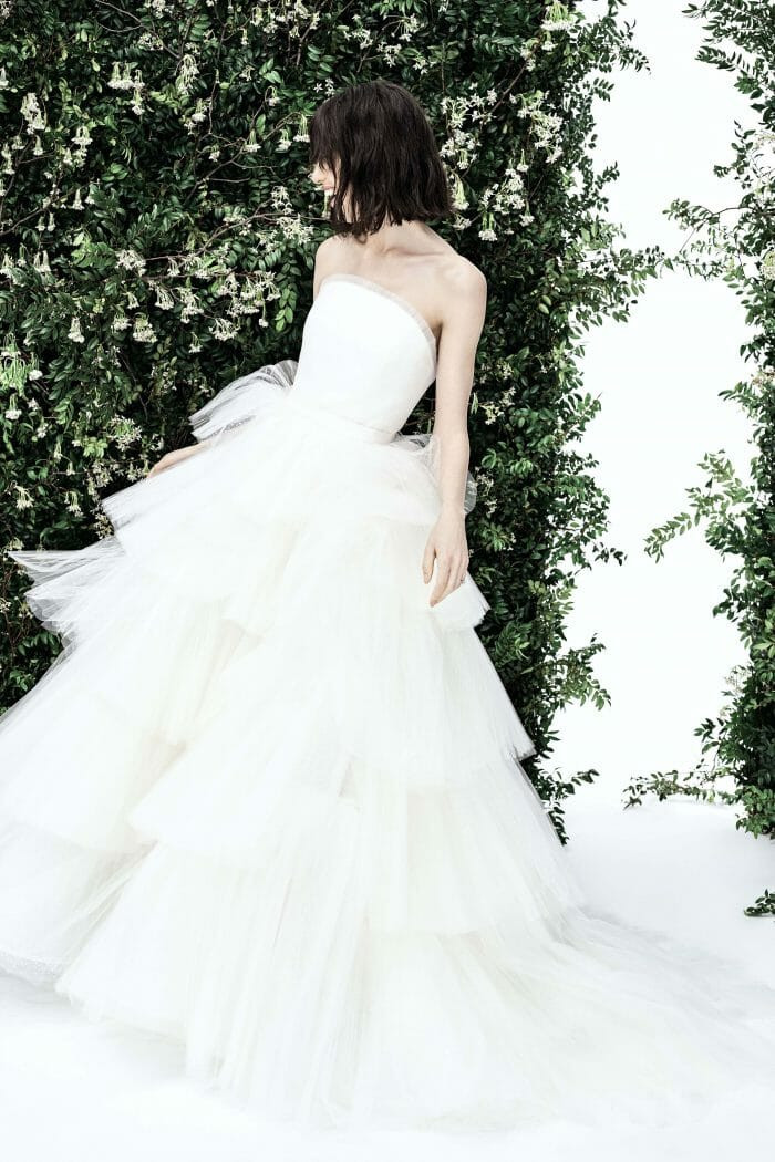 A Carolina Herrera strapless ball gown wedding dress with a layered tulle skirt