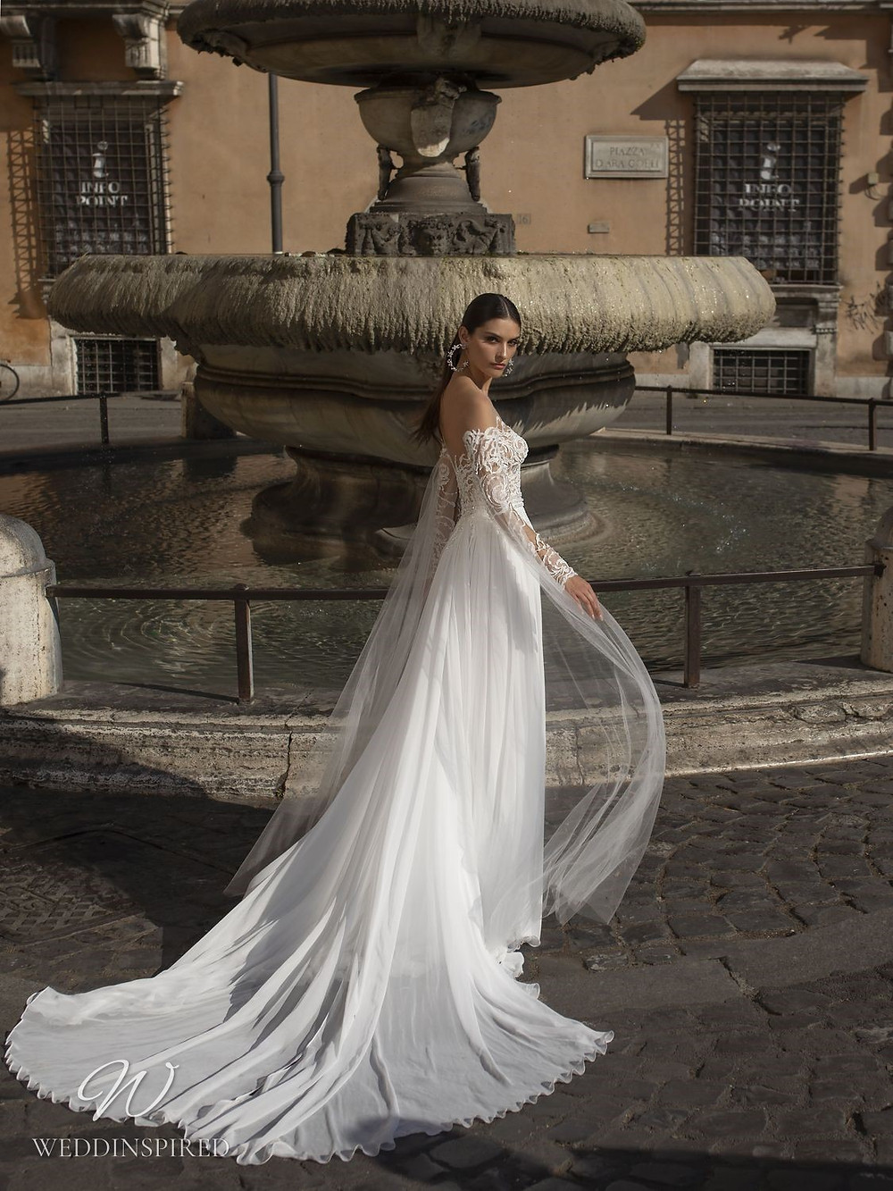 A Pinella Passaro off the shoulder lace and chiffon A-line wedding dress with long sleeves