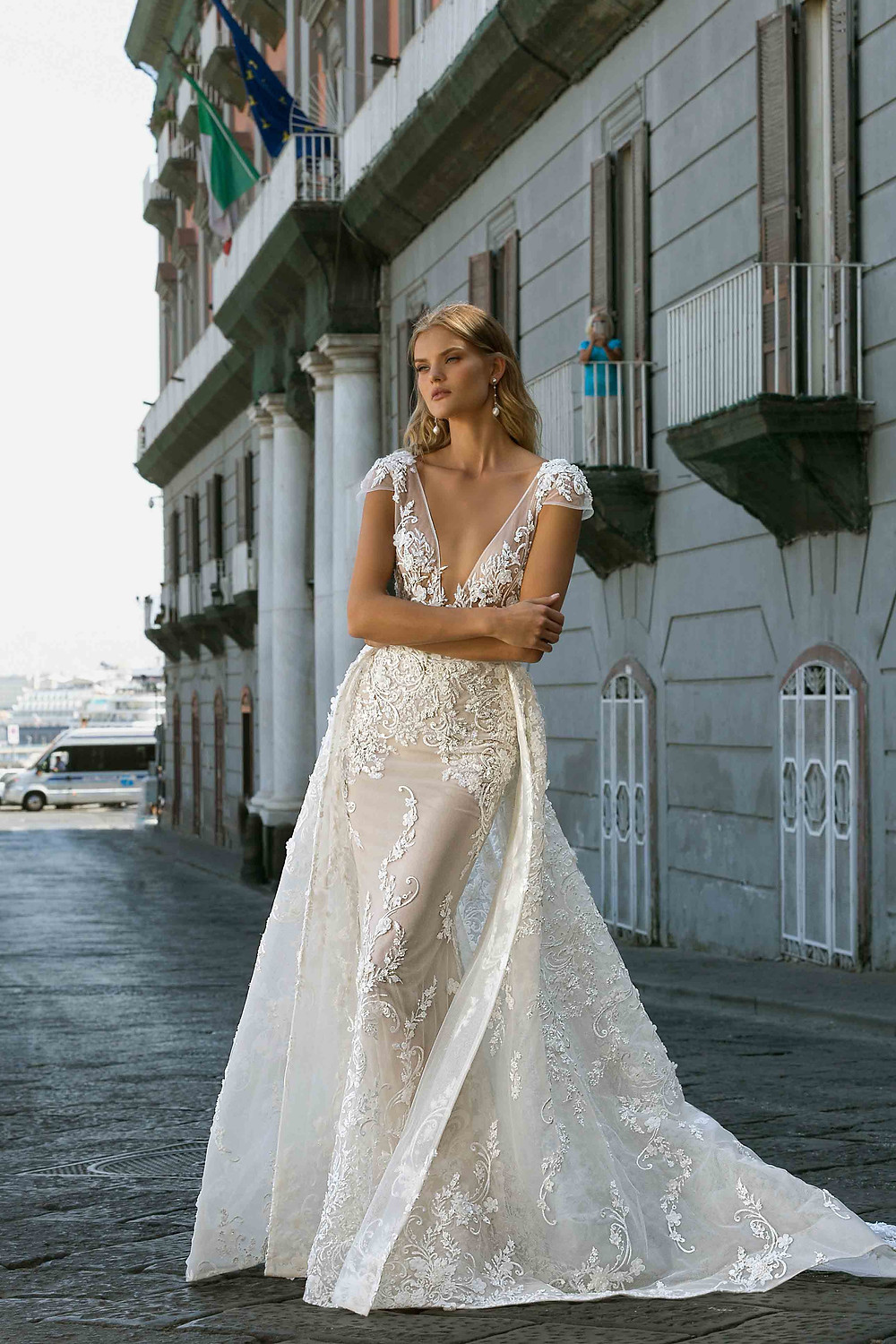 A Berta 2020 lace mermaid wedding dress, with low v neckline and detachable skirt