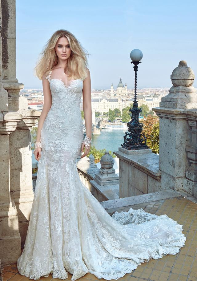 A Galia Lahav lace mermaid fit and flare wedding dress with cap sleeves