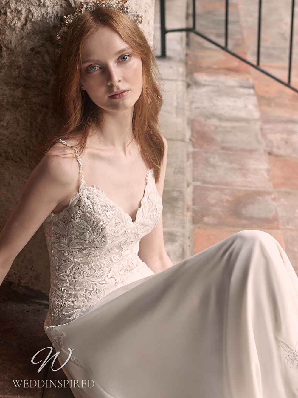 A Maggie Sottero Spring 2021 lace and crepe sheath wedding dress with straps and a v neck