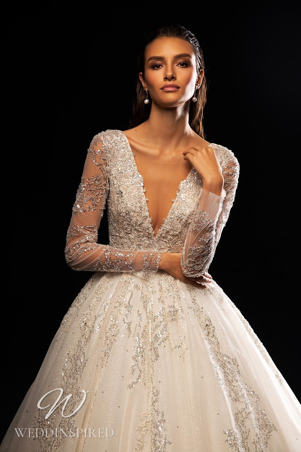 A WONÁ Concept 2021 tulle princess wedding dress with long sleeves