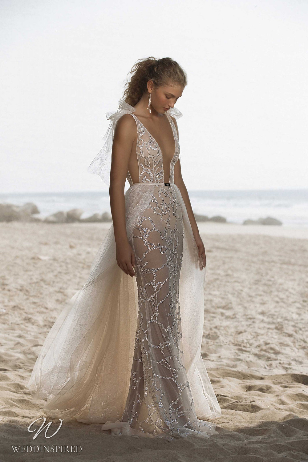 A Muse by Berta mesh and tulle ivory beach mermaid wedding dress with a detachable skirt and a v neckline