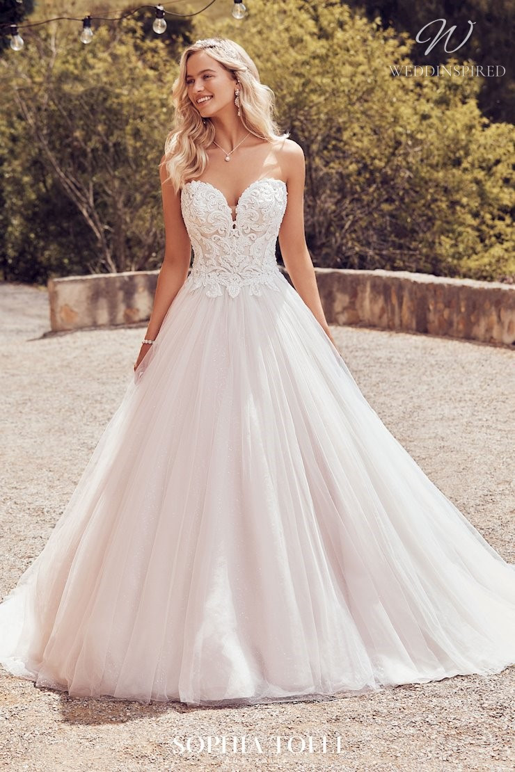 A Sophia Tolli strapless lace and tulle ball gown wedding dress