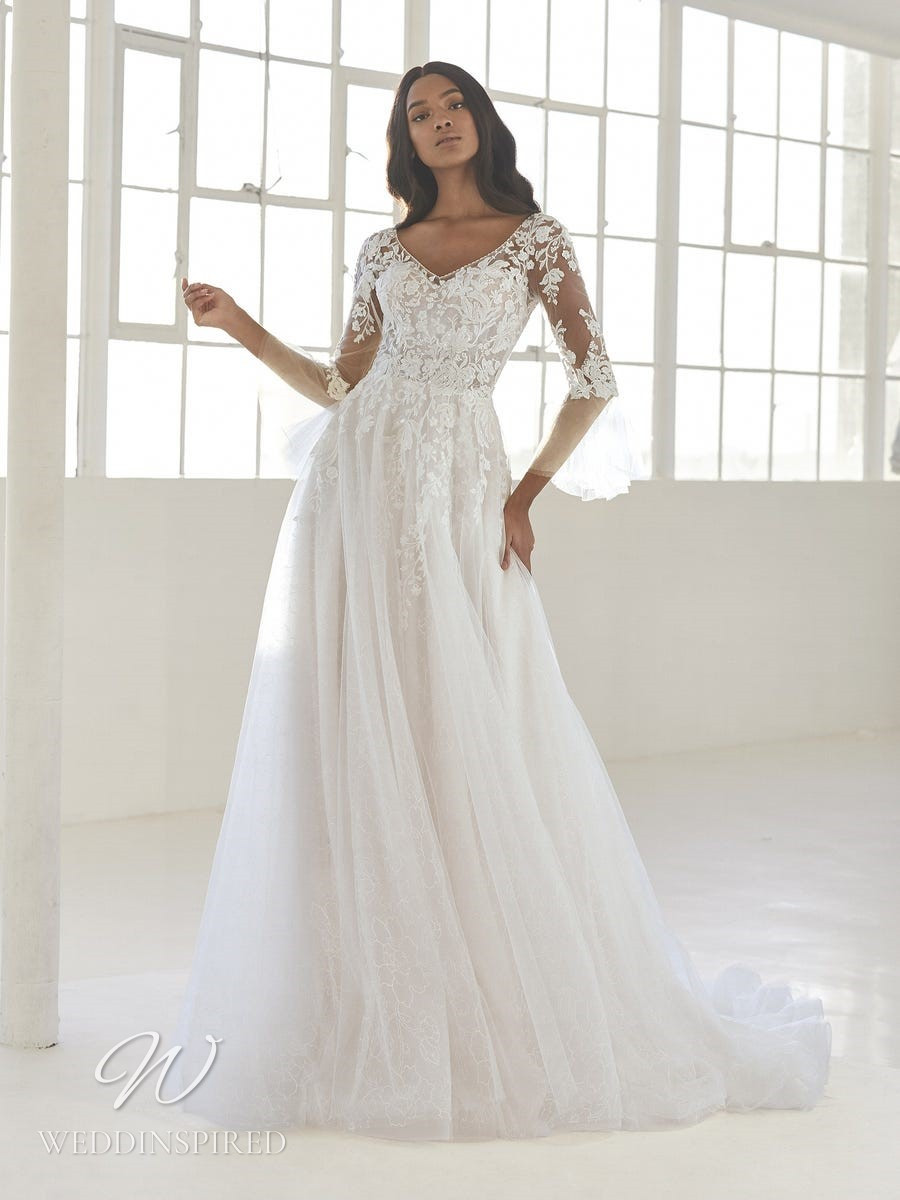 An Ashley Graham x Pronovias 2021 lace and tulle A-line wedding dress with long sleeves
