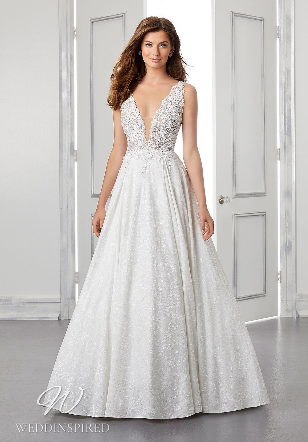 A Madeline Gardner lace A-line wedding dress with a v neck