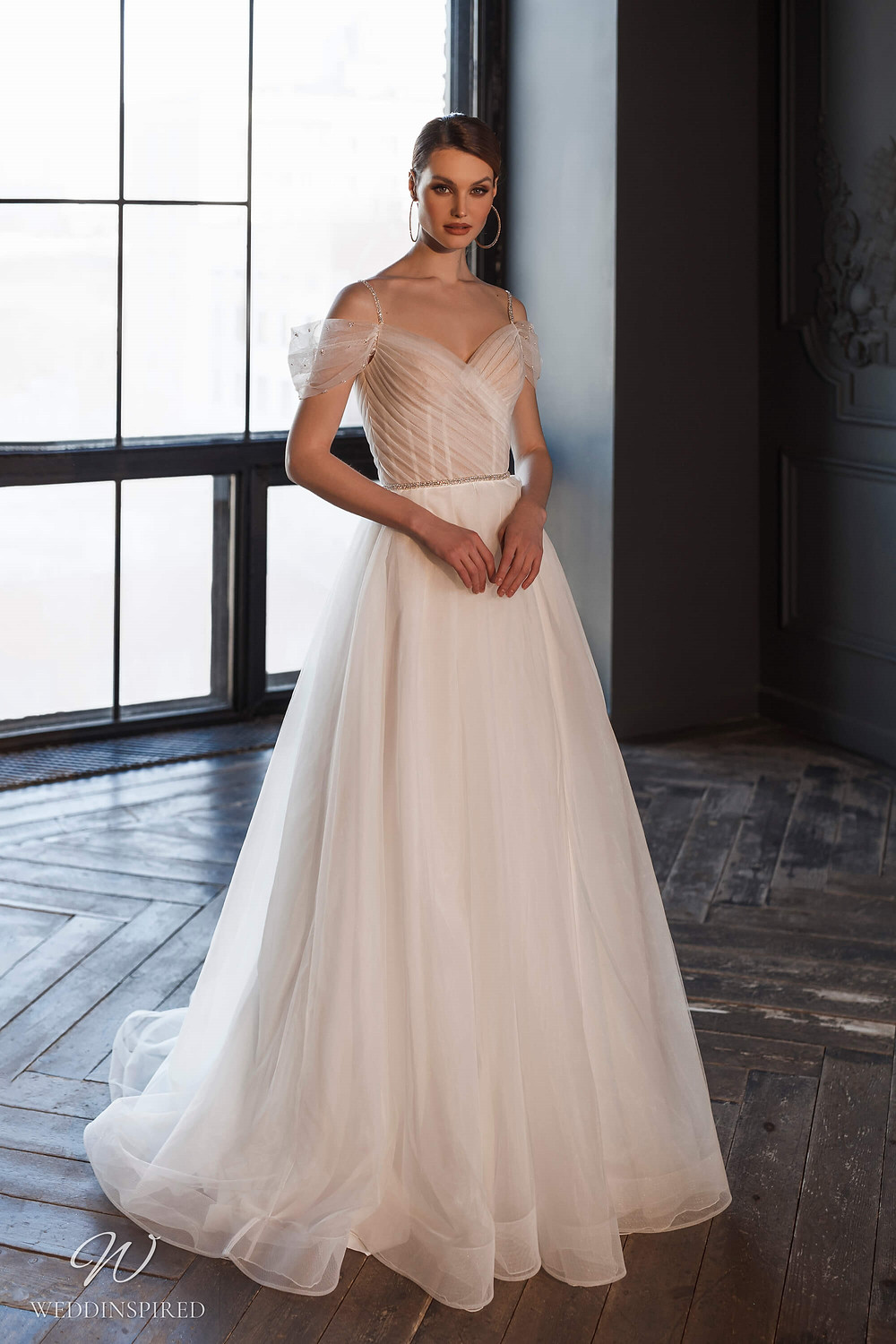 A Naviblue Bridal 2021 blush off the shoulder tulle A-line wedding dress