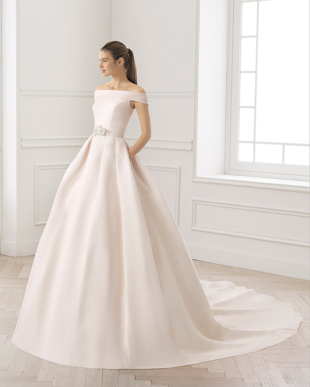 An Aire Barcelona 2020 blush pink off the shoulder silk ball gown wedding dress with pockets