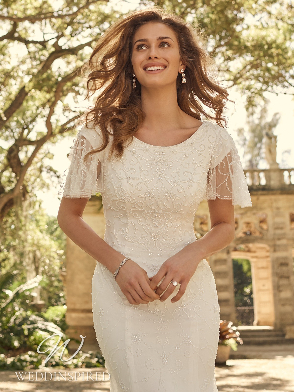 A Maggie Sottero 2021 simple beaded mermaid wedding dress