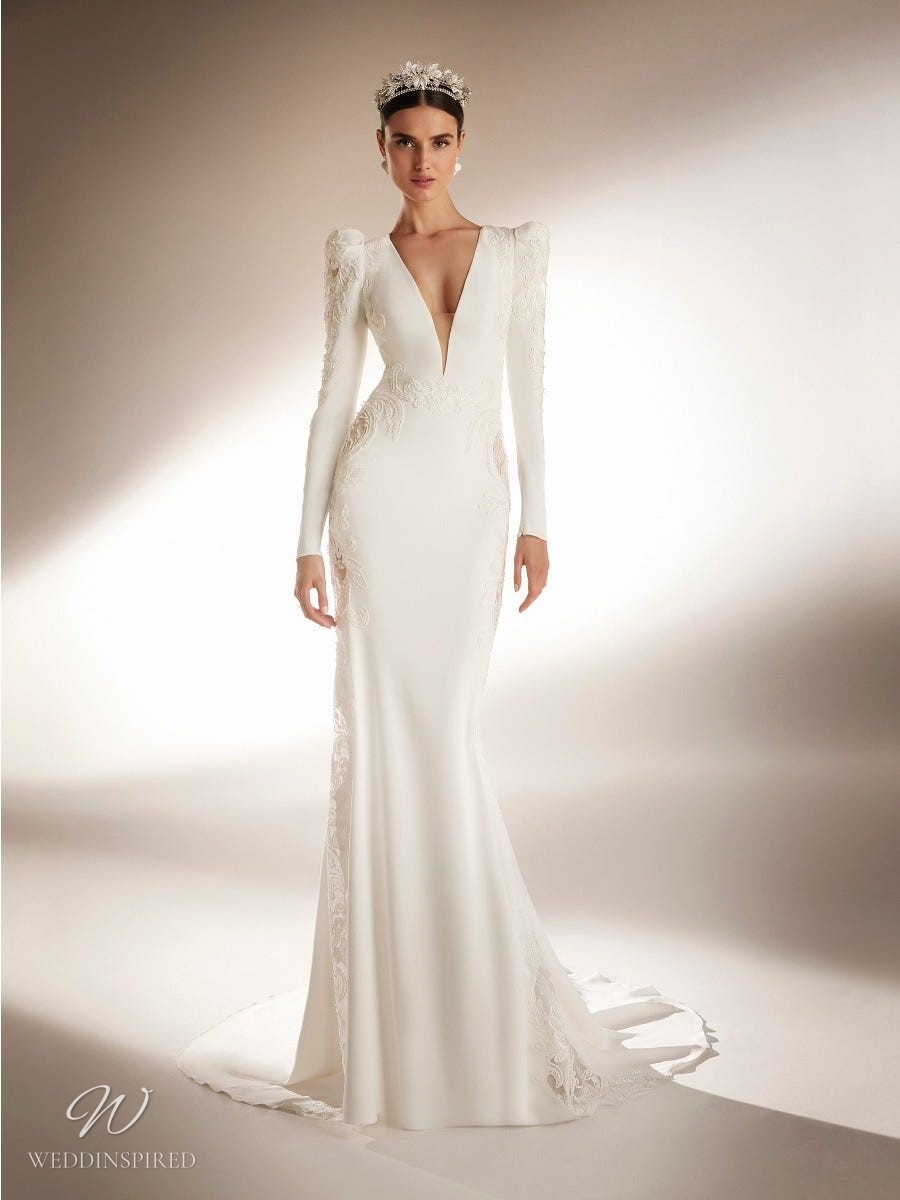 An Atelier Pronovias mermaid wedding dress with lace, long sleeves and a low v neckline