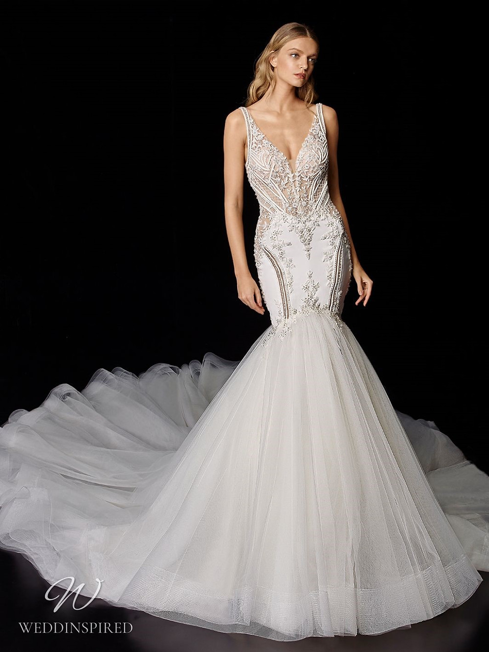 An Enzoani lace and tulle mermaid wedding dress with a train