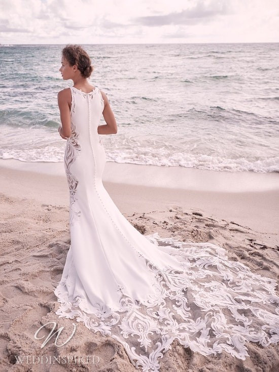 A Sottero & Midgley Spring 2021 lace and crepe mermaid wedding dress with a train
