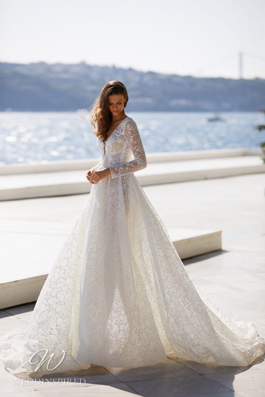 A Milla Nova 2021 lace A-line wedding dress with long sleeves and a v neck