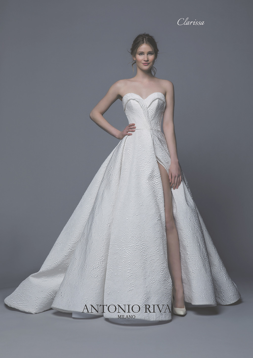 An Antonio Riva 2020 strapless ball gown wedding dress with a high slit and a sweetheart neckline