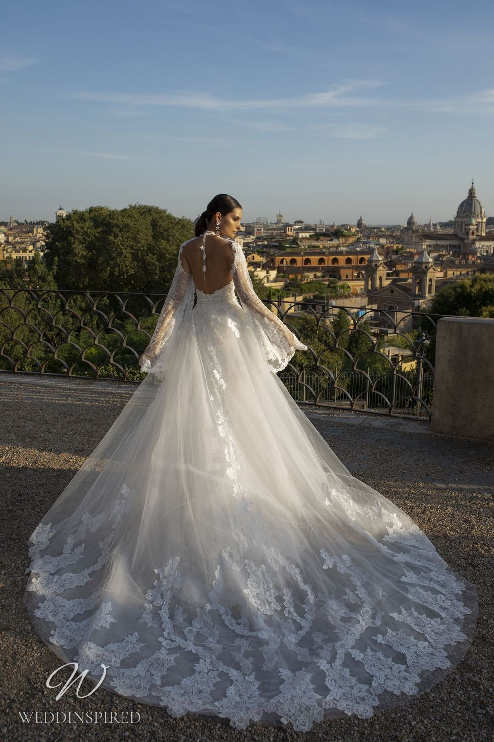 A Pinella Passaro lace and tulle ball gown wedding dress with long sleeves and a low back