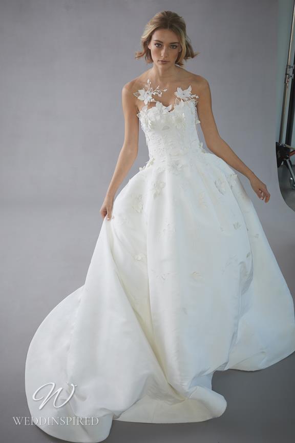 An Oscar de la Renta 2022 strapless lace and taffeta A-line wedding dress