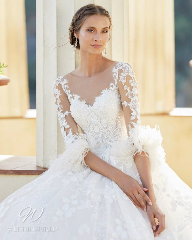 A Rosa Clara 2021 lace princess ball gown wedding dress with long sleeves