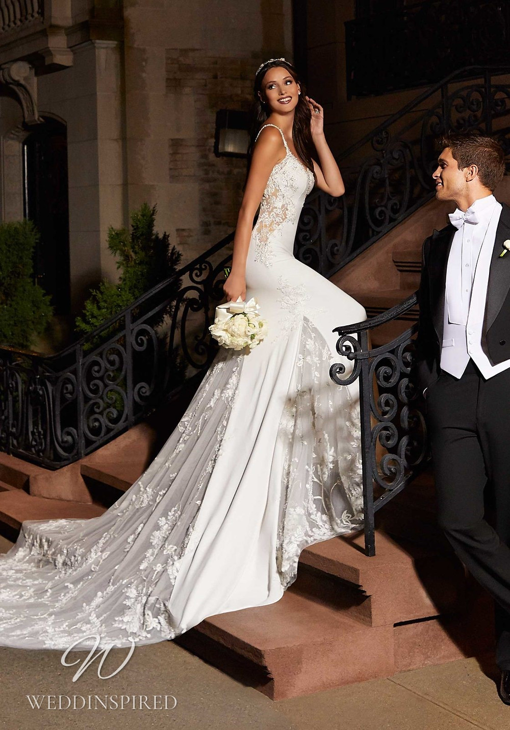A Madeline Gardner lace and satin mermaid wedding dress with straps