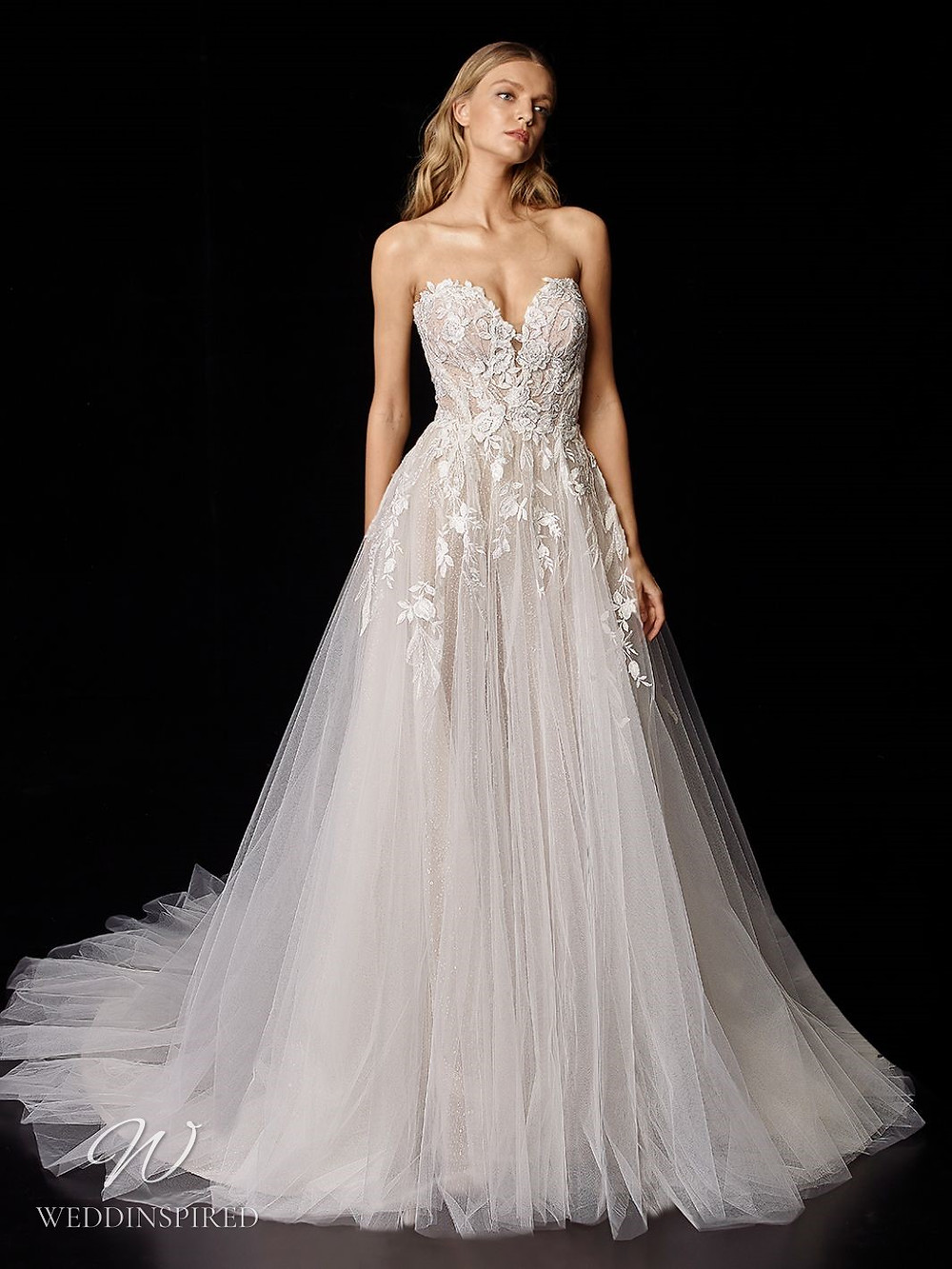 An Enzoani strapless romantic lace and tulle ball gown wedding dress with a sweetheart neckline