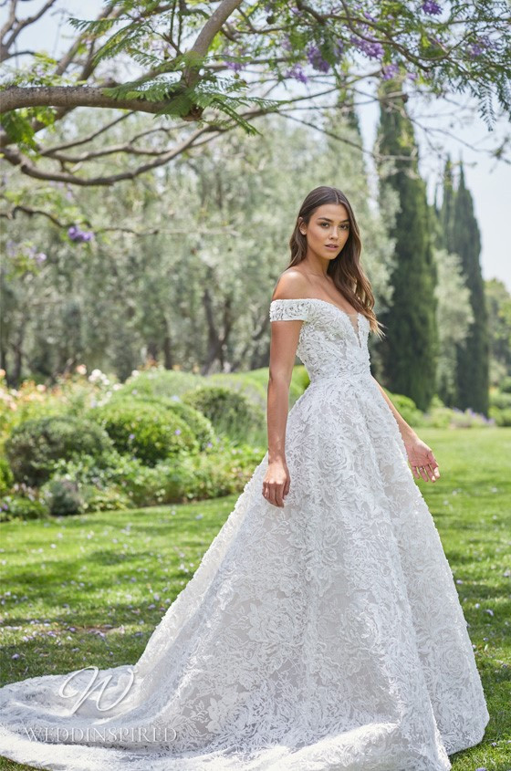 A Monique Lhuillier lace off the shoulder ball gown wedding dress