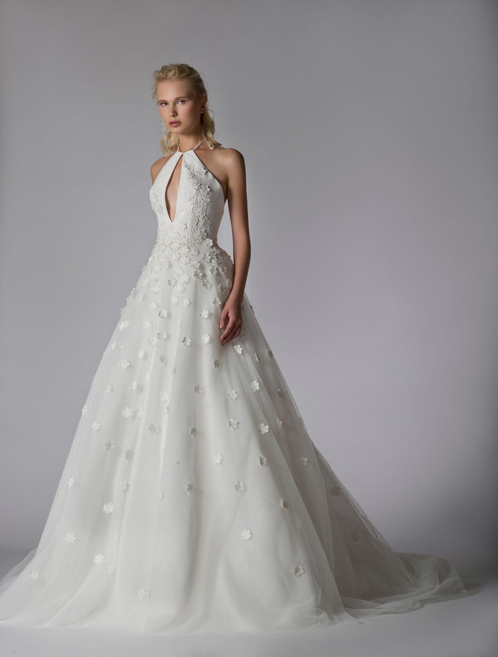 A Georges Hobeika halterneck ball gown wedding dress with flowers