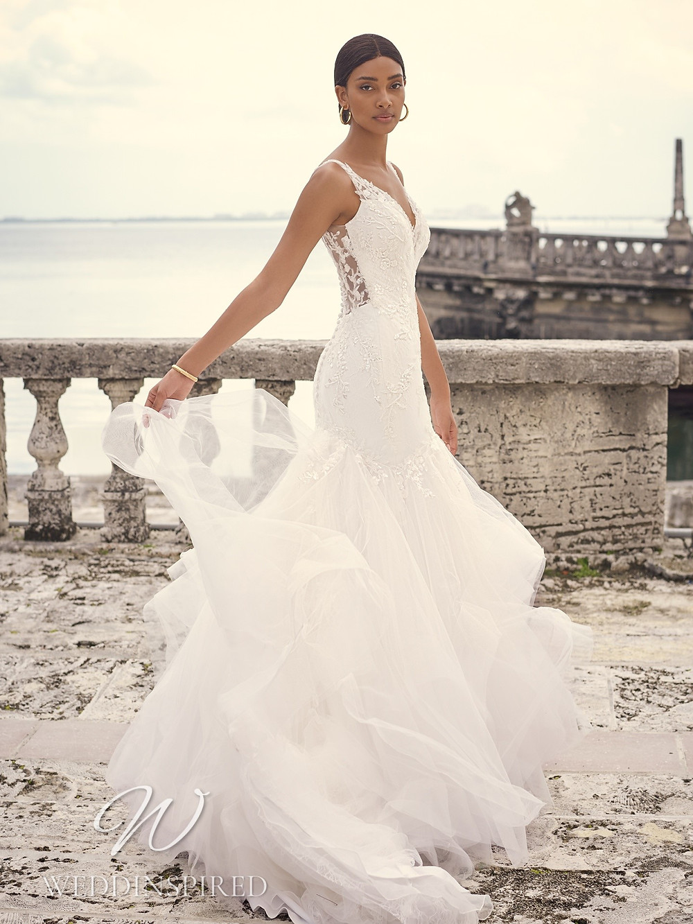 A Sottero & Midgley 2021 lace and tulle mermaid wedding dress