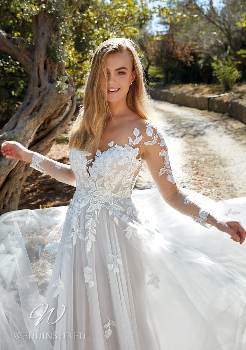 An Eddy K 2022 lace and tulle A-line wedding dress with long sleeves
