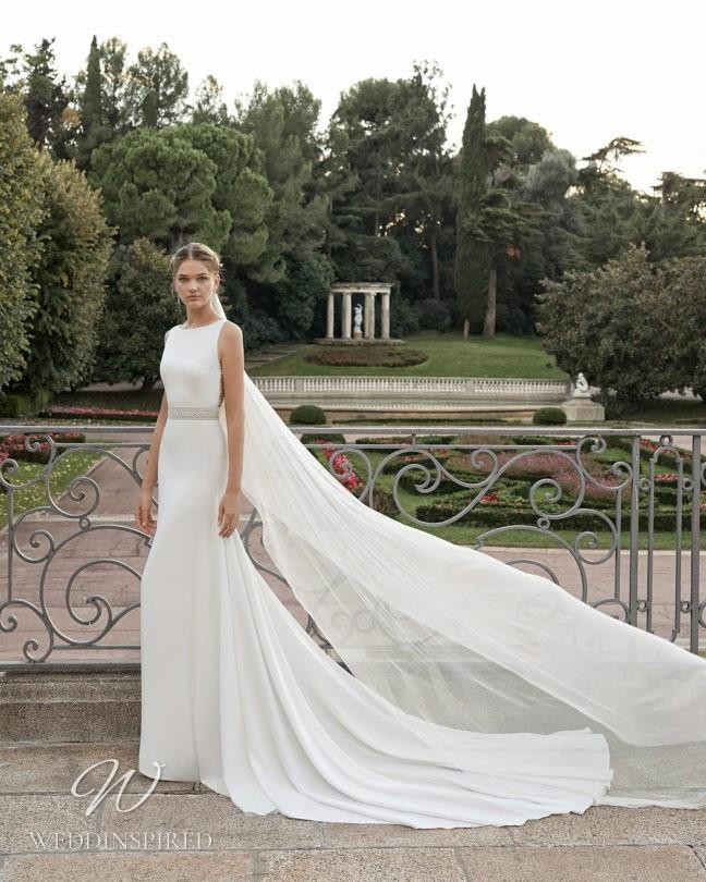 An Aire Barcelona 2021 flowy mermaid wedding dress with a high neckline