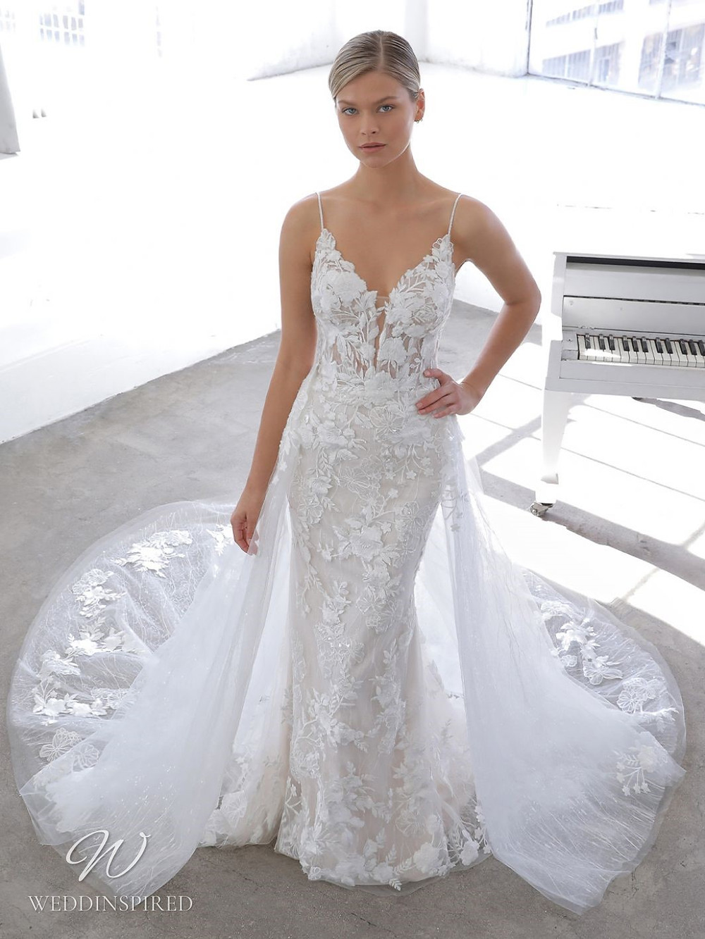A Blue by Enzoani 2021 lace mermaid wedding dress with straps, a v neck and a detachable skirt