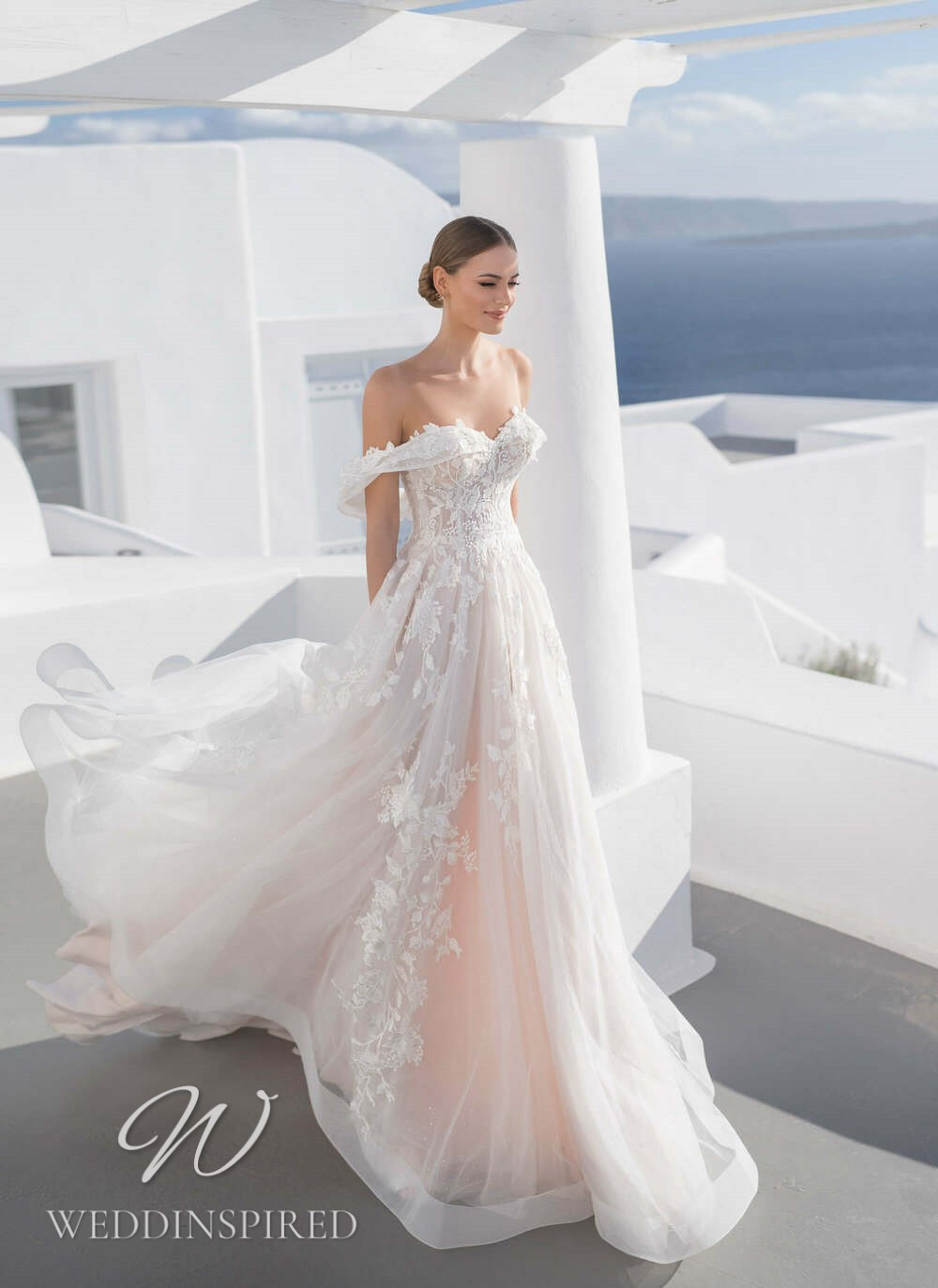 A Blunny 2021 blush off the shoulder lace and tulle A-line wedding dress