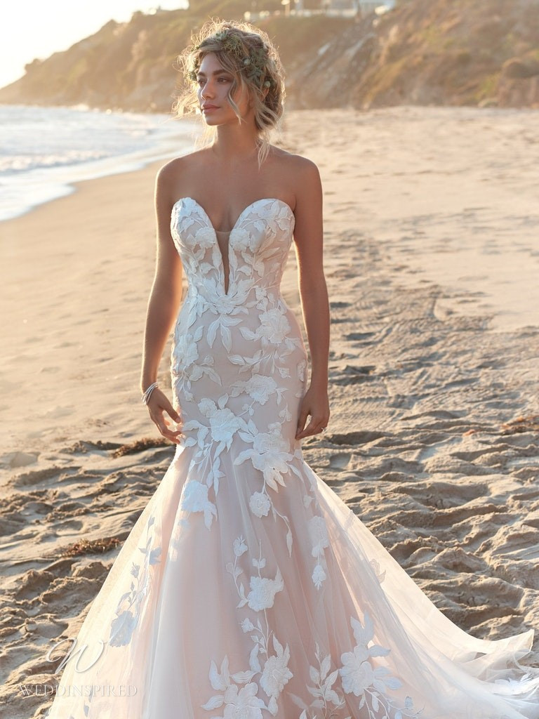A Rebecca Ingram 2020 strapless blush lace and tulle mermaid wedding dress with a sweetheart neckline