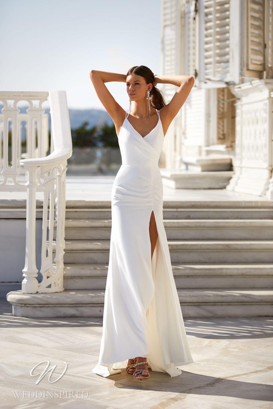 A Milla Nova 2021 simple satin mermaid wedding dress with straps, a v neck and a slit