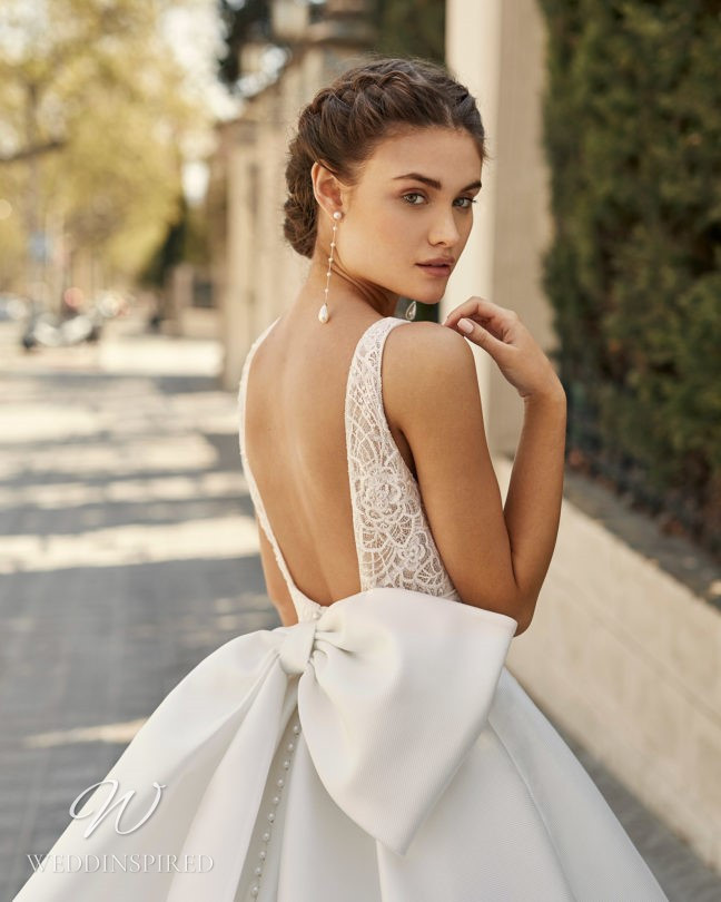 An Aire Barcelona 2021 princess ball gown wedding dress with a low back and a bow