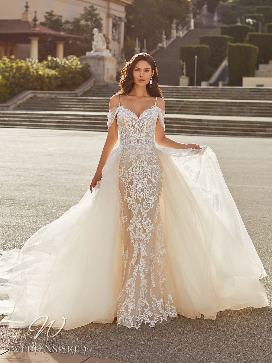 A Pronovias Privée 2021 off the shoulder blush lace and mesh mermaid wedding dress with a detachable skirt and straps