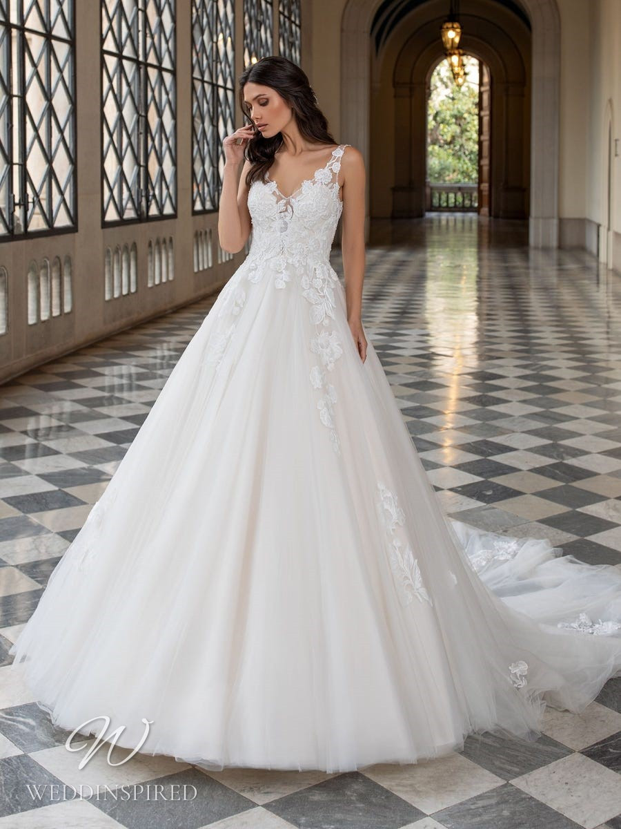 A Pronovias 2021 lace and tulle princess ball gown wedding dress with straps and a v neck