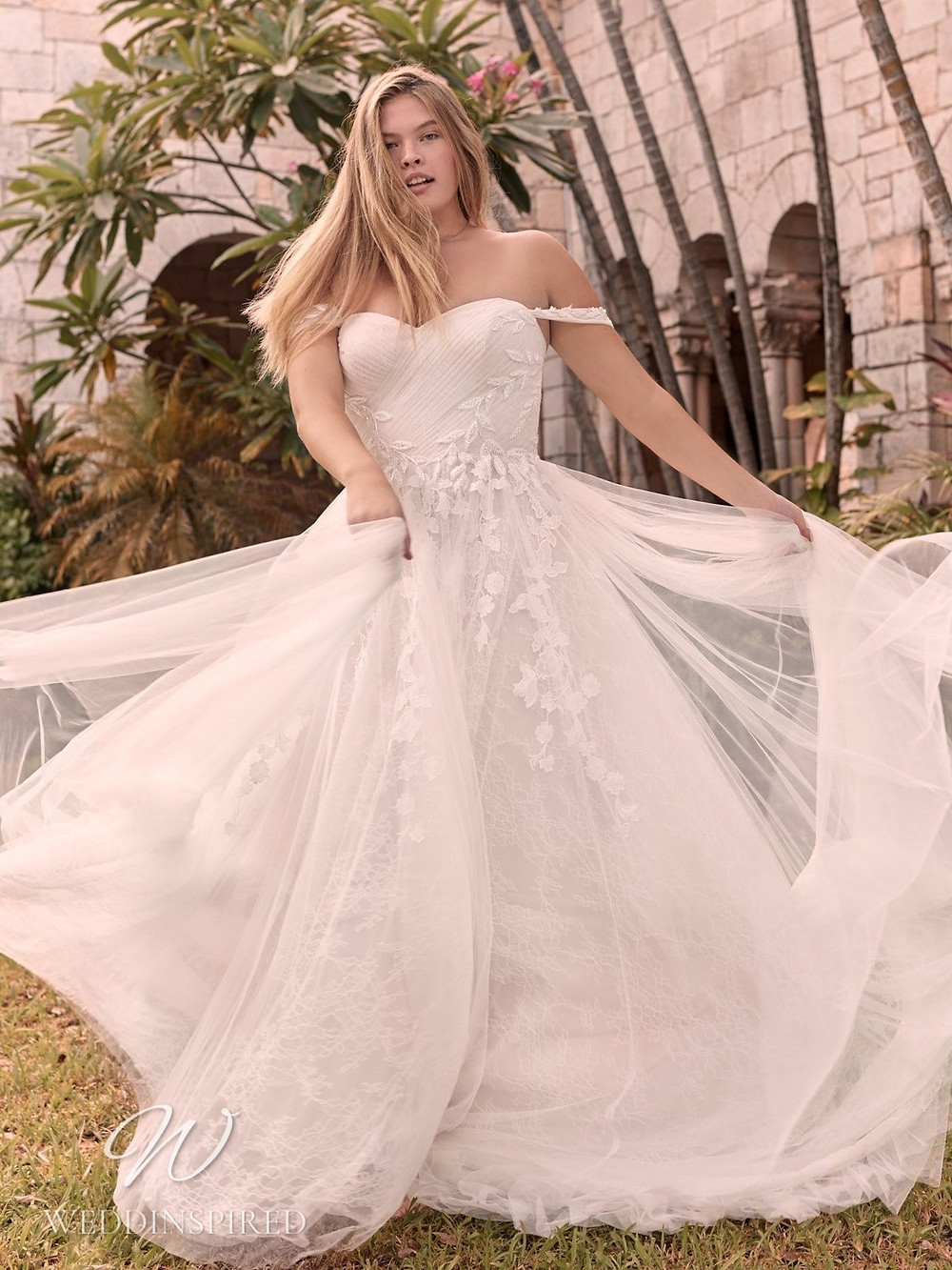A Rebecca Ingram Spring 2021 off the shoulder lace and mesh A-line wedding dress