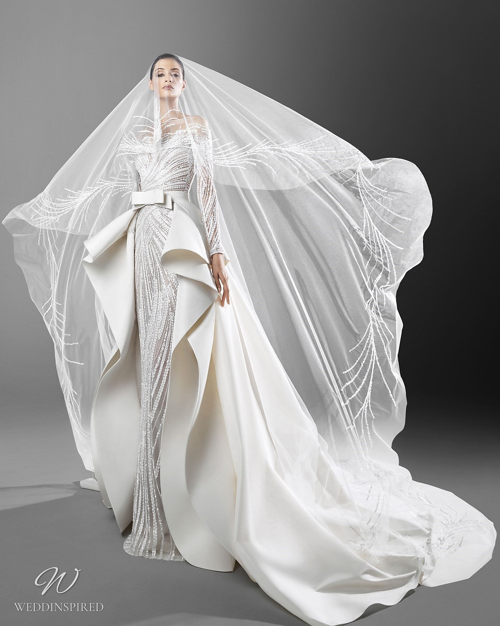 A Zuhair Murad mermaid wedding dress with crystals, a detachable skirt, an illusion neckline and a veil