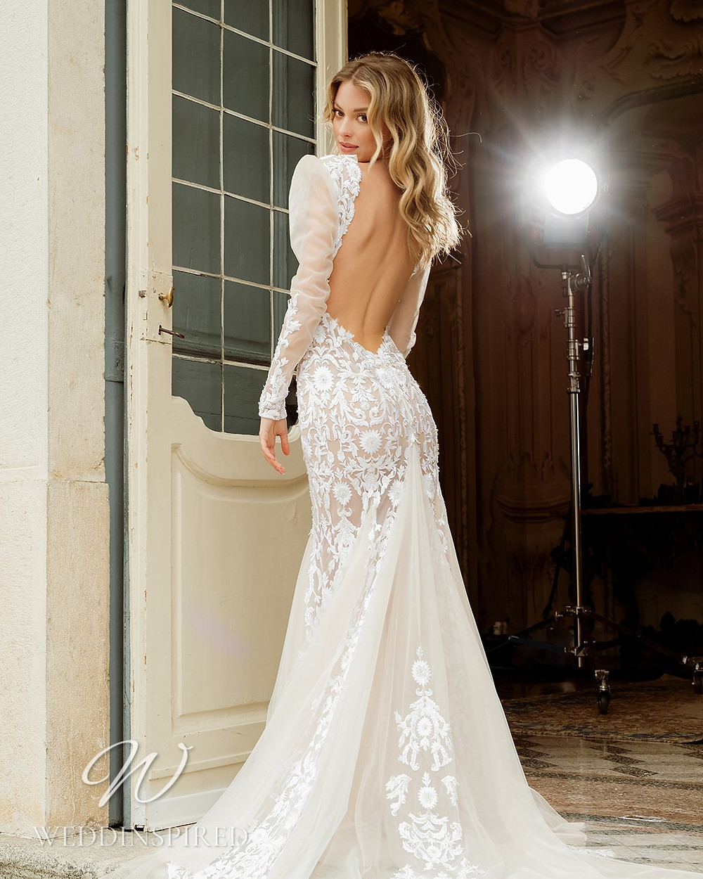 A Berta 2022 lace and tulle mermaid wedding dress with long sleeves