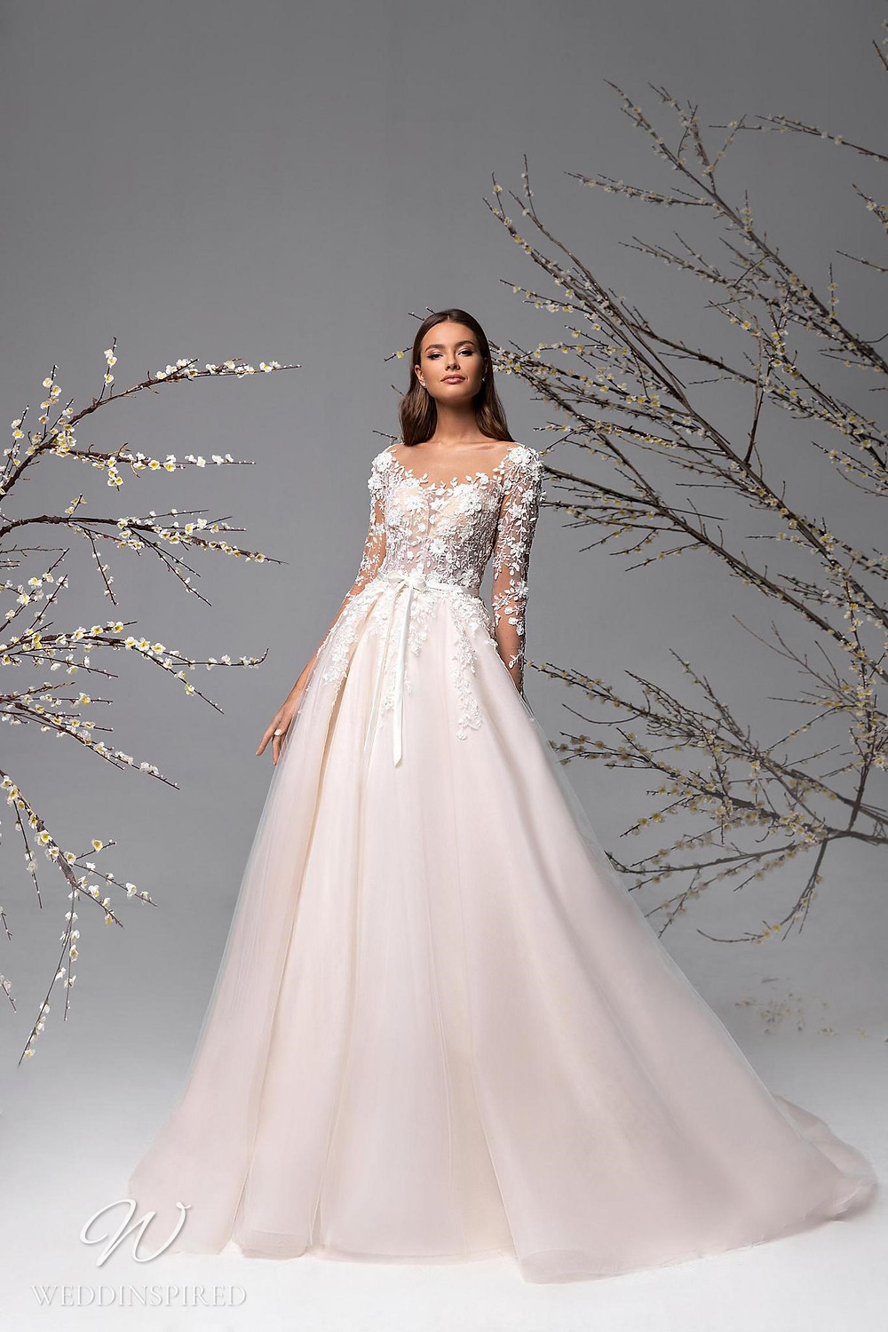 A Ricca Sposa blush lace and tulle A-line wedding dress
