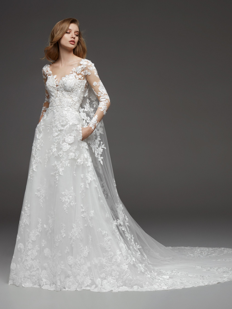 A Pronovias romantic lace and mesh A-line wedding dress with pockets and long sleeves