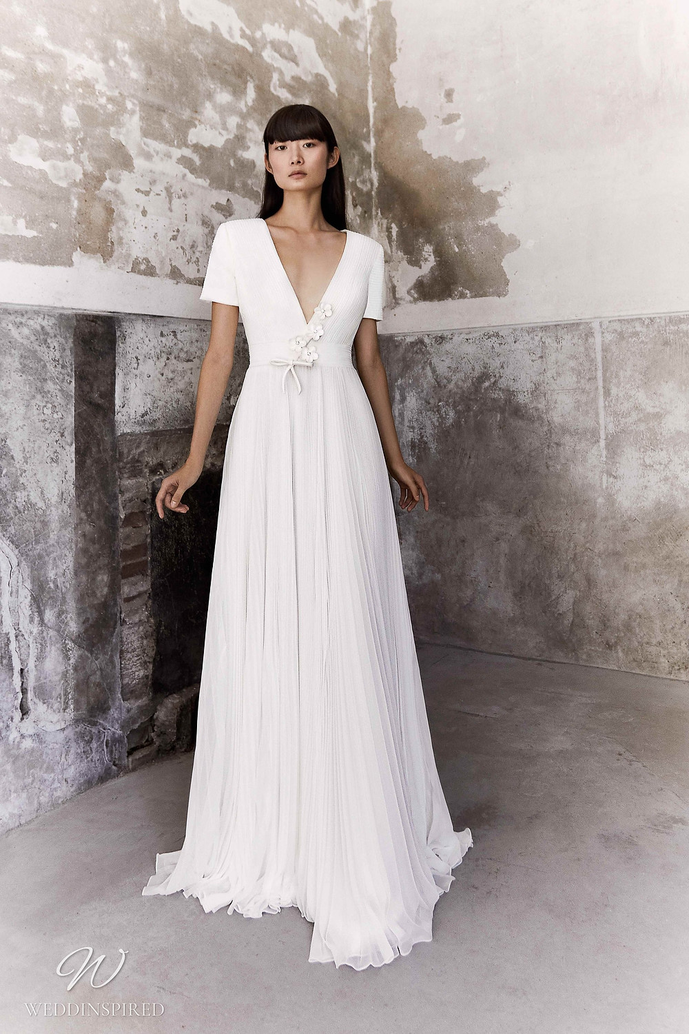 A Viktor & Rolf Fall/Winter 2021 simple A-line wedding dress with a v neck and short sleeves