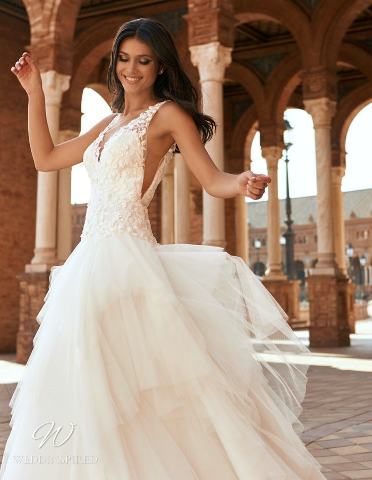 A Marchesa for Pronovias 2022 ivory lace and tulle A-line wedding dress with a v neck and a ruffle skirt