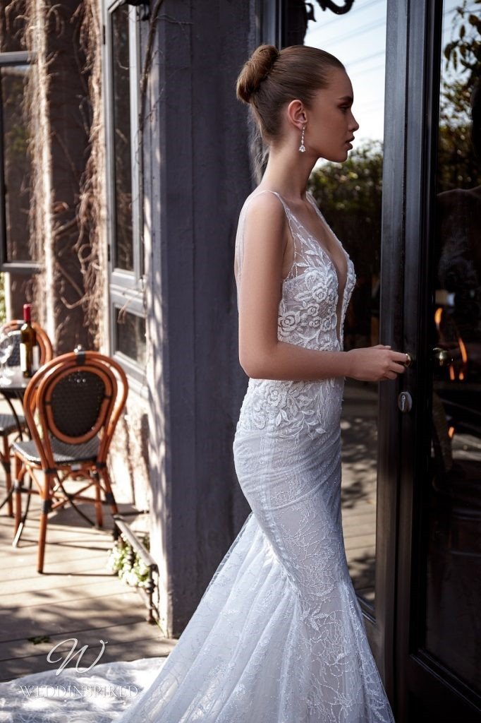 A Julie Vino 2021 lace mermaid wedding dress with a low v neckline