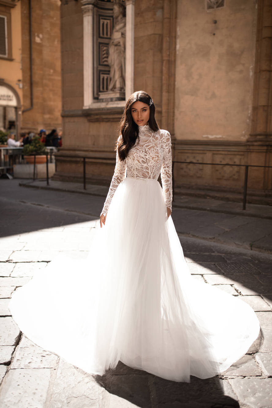 A Milla Nova lace and tulle ball gown wedding dress with long sleeves