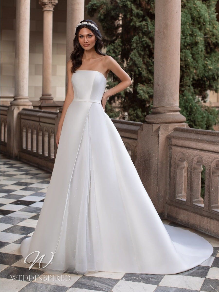 An Ashley Graham x Pronovias 2021 strapless satin A-line wedding dress