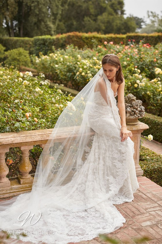A Monique Lhuillier Bliss Fall 2021 strapless lace mermaid wedding dress with a train