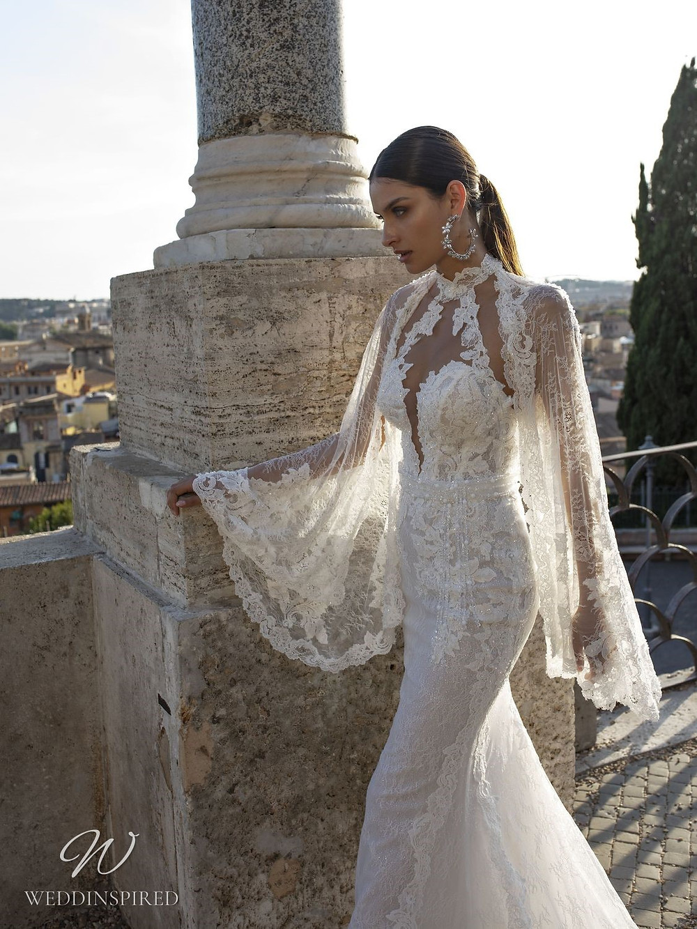 A Pinella Passaro lace mermaid wedding dress with long bell sleeves