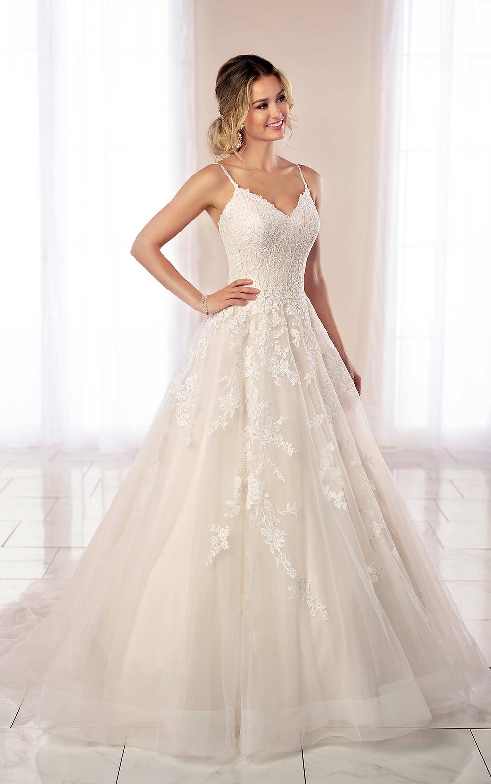 A Stella York 2020 lace and mesh princess ball gown wedding dress with straps