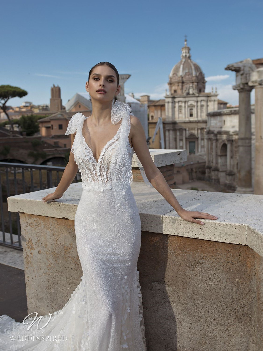 A Pinella Passaro lace mermaid wedding dress with a low neckline and bows