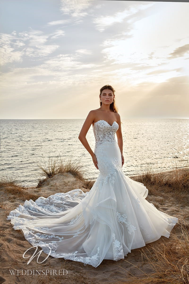 An Eddy K 2022 strapless lace and tulle mermaid wedding dress